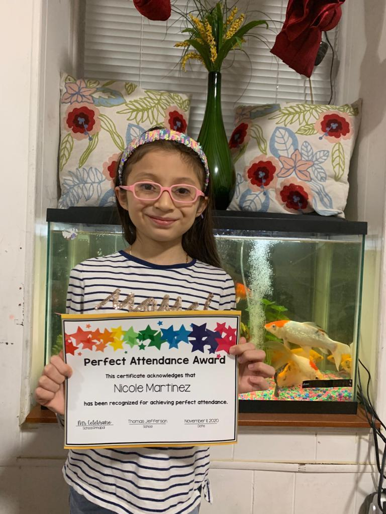 Nicole Martinez holding perfect attendance certificate