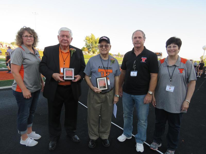Members of the TK Alumni Association present awards to Dr. James Gibson and Walt Eavey.