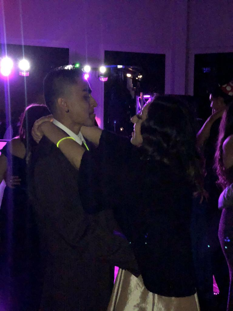 Couple dances at prom