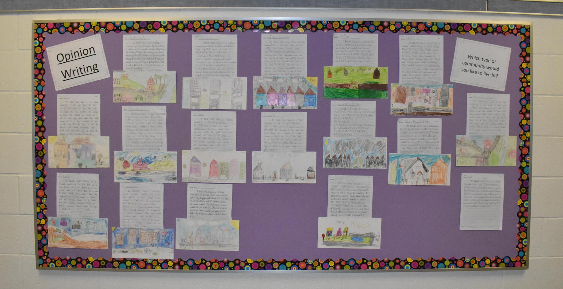 A collection of second graders opinion writing pieces about which community they would prefer to live in.