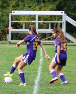 Francesca skillfully moves the ball down the field.