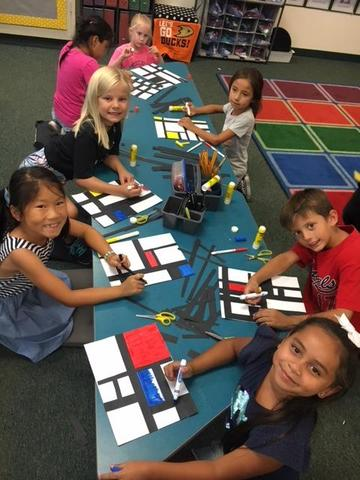 Second graders working on an art project