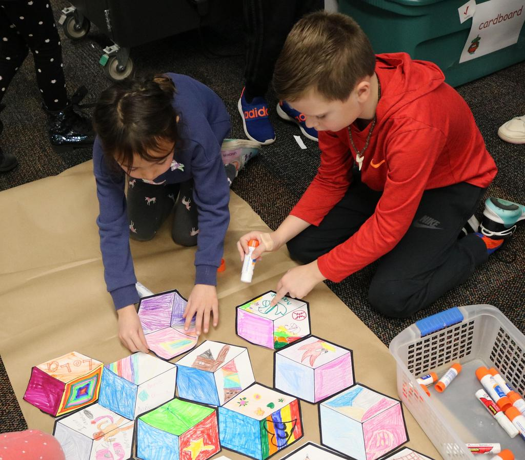Photo of two Tamaques 2nd graders working on collaborative street art project on STEAM Day.