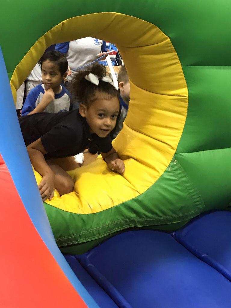girl entering the bouncy house