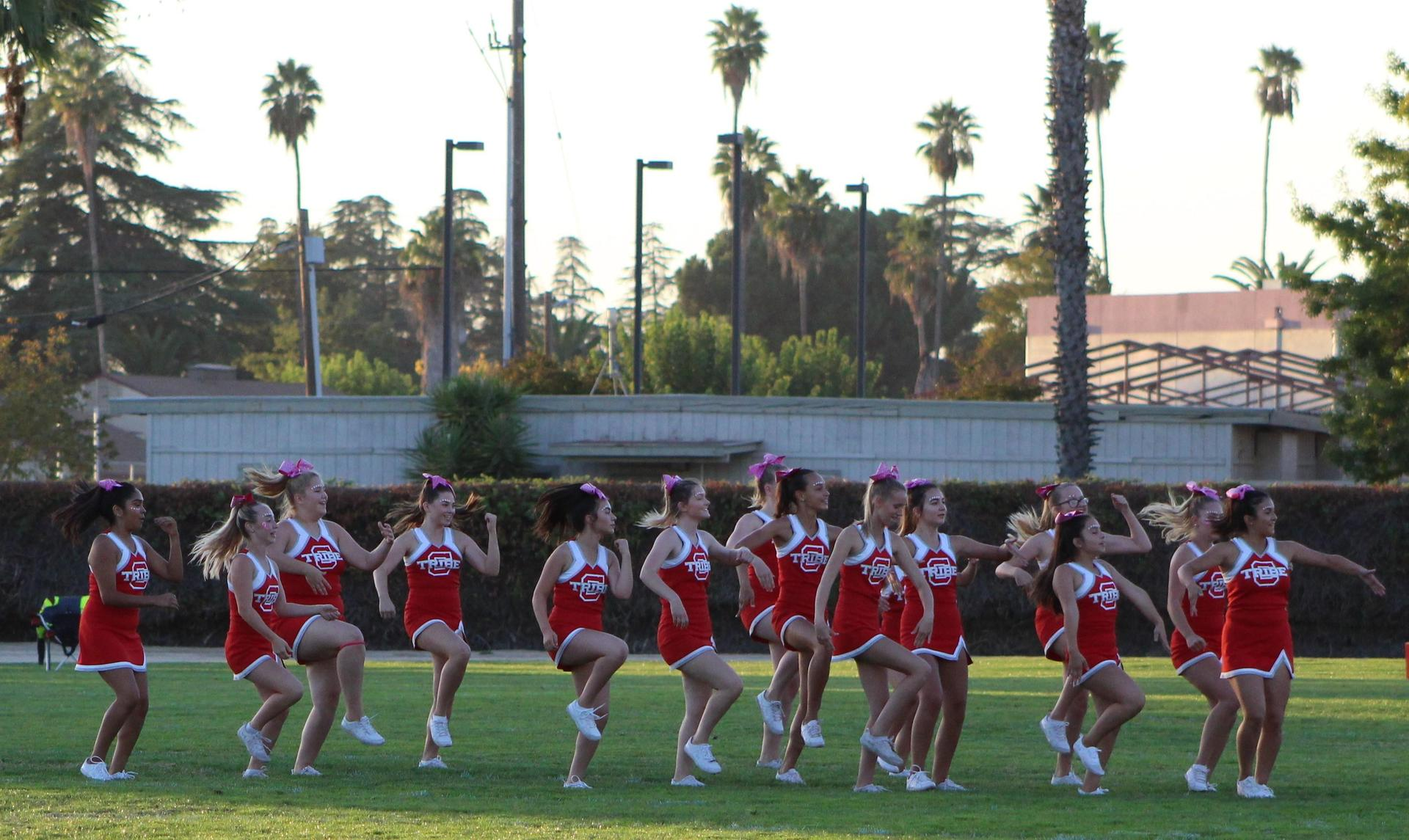 Junior Varsity boys and cheerleaders at the football game against Yosemite