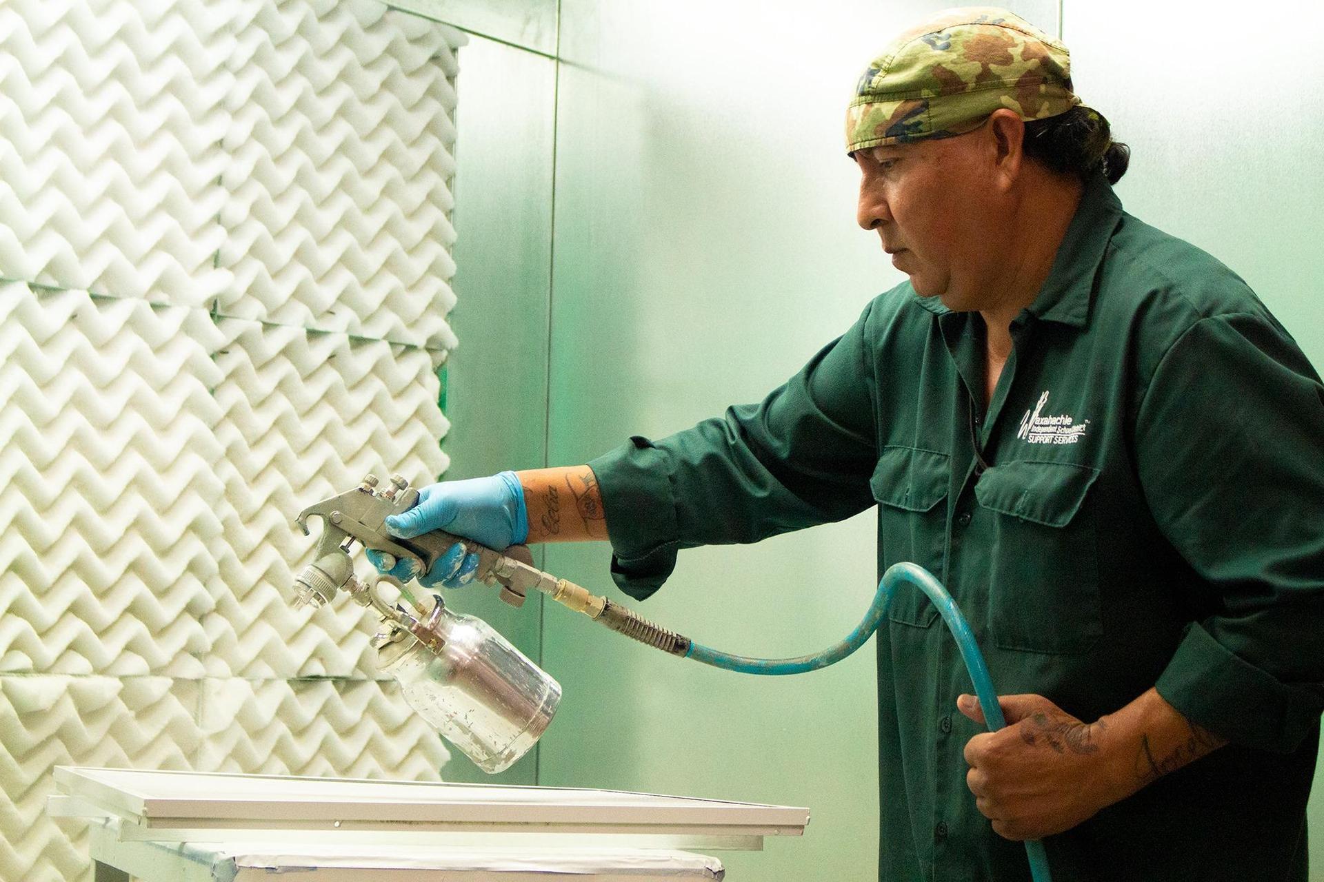 man spray painting