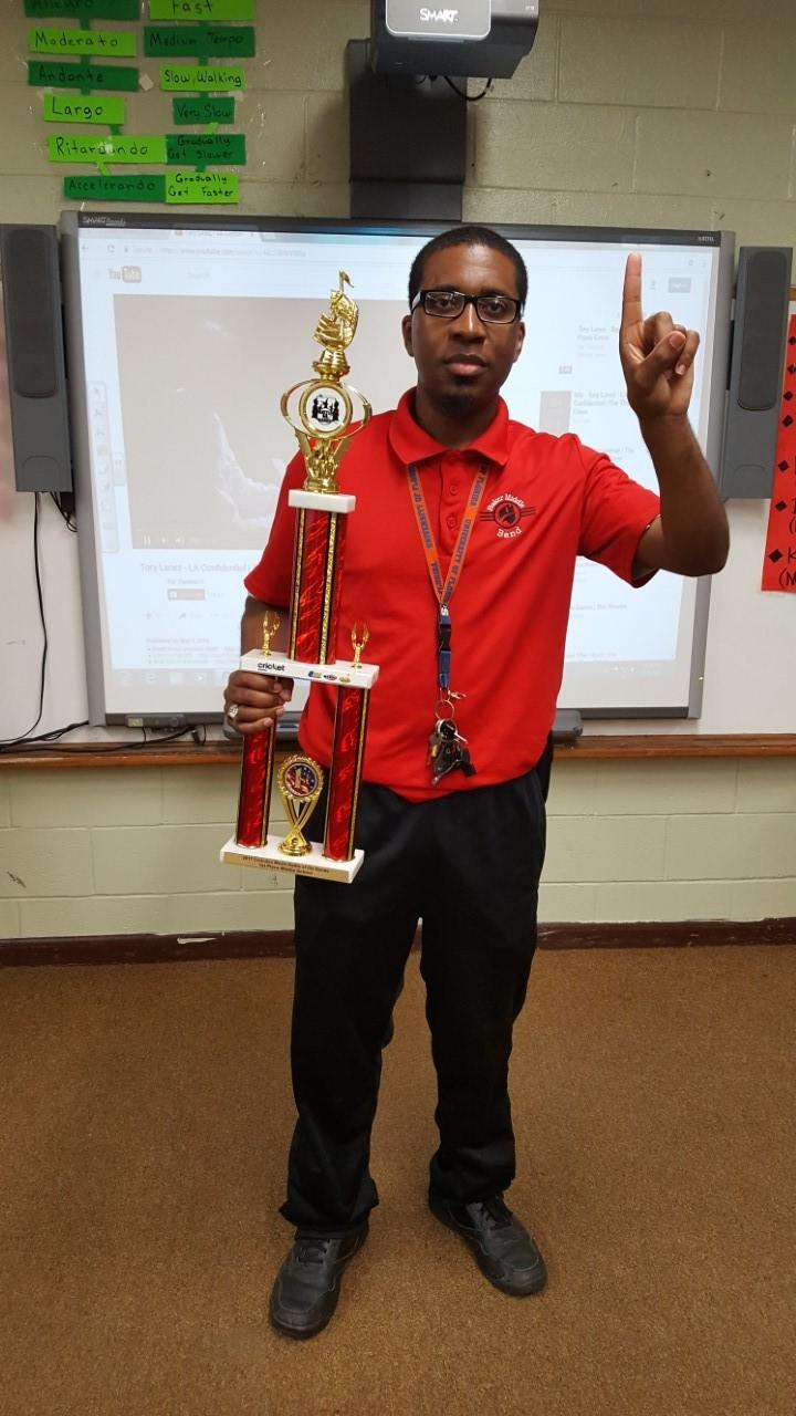 Baker Middle Band Students hold winning trophy from battle of the bands