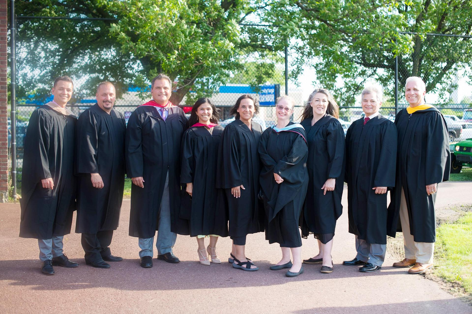 Elected officials and Superintendent Priya Tahiliani, in graduation gowns, prior to the commencement exercises