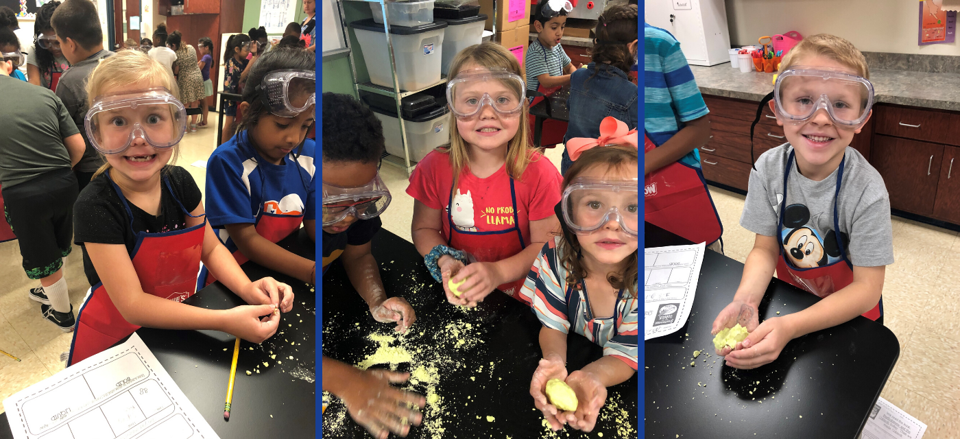 students in safety goggles and aprons working on science experiment