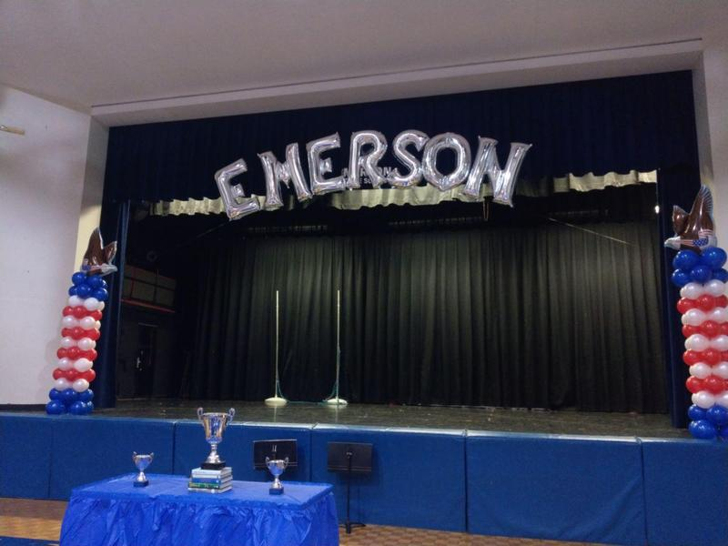 Emerson dressed up stage with ballons and awards