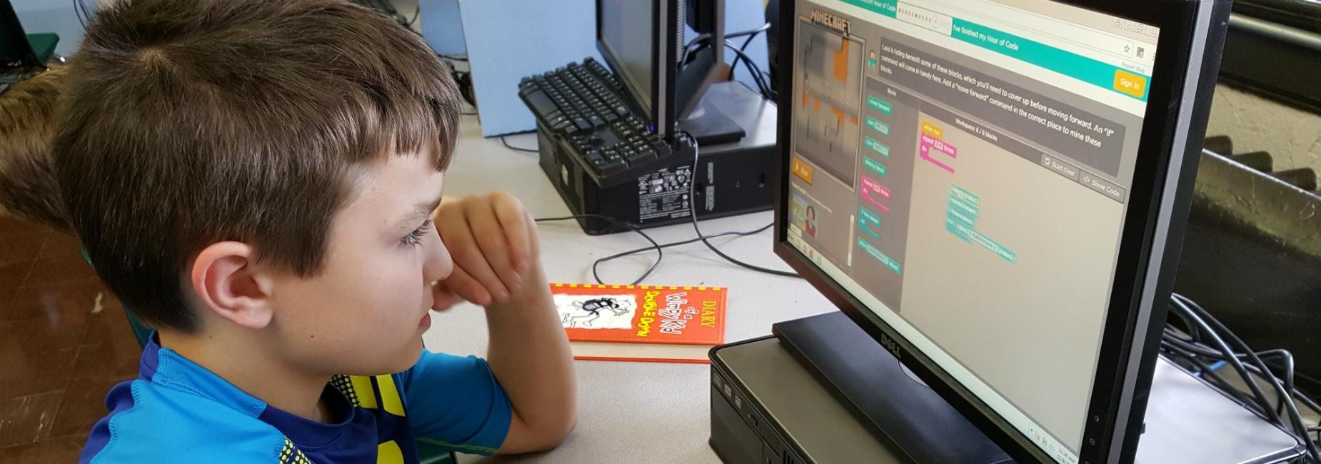 Student writing Blockly code during annual Hour of Code