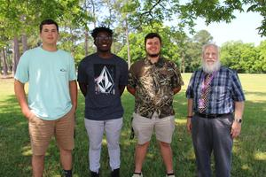 Pictured from left to right are Bryce Burkett, Vernard Ramage, and Caden Bryant.  They are pictured with Dr. Teddy Higgins from American Legion Auxiliary Post 61.
