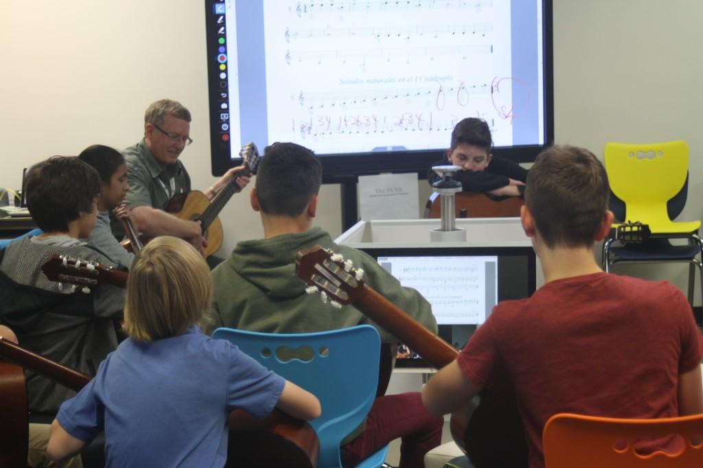 Music students test out the technology in the new room at STEM, called the SYNK (Synchronous Learning Room).