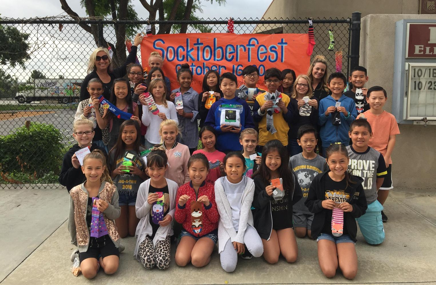 Students collecting socks for Socktoberfest