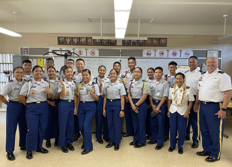 WHS Army JROTC group photo 17 students and 3 teachers, posing with their stars for earning Honor Unit with Distinction