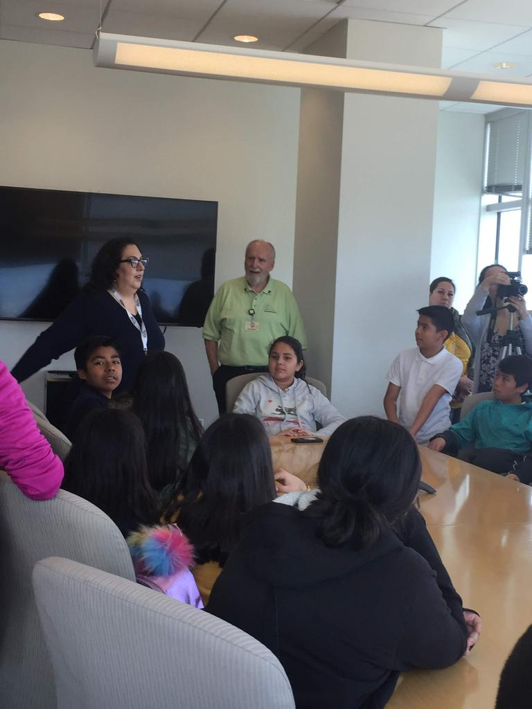 students gather in conference room with city council member