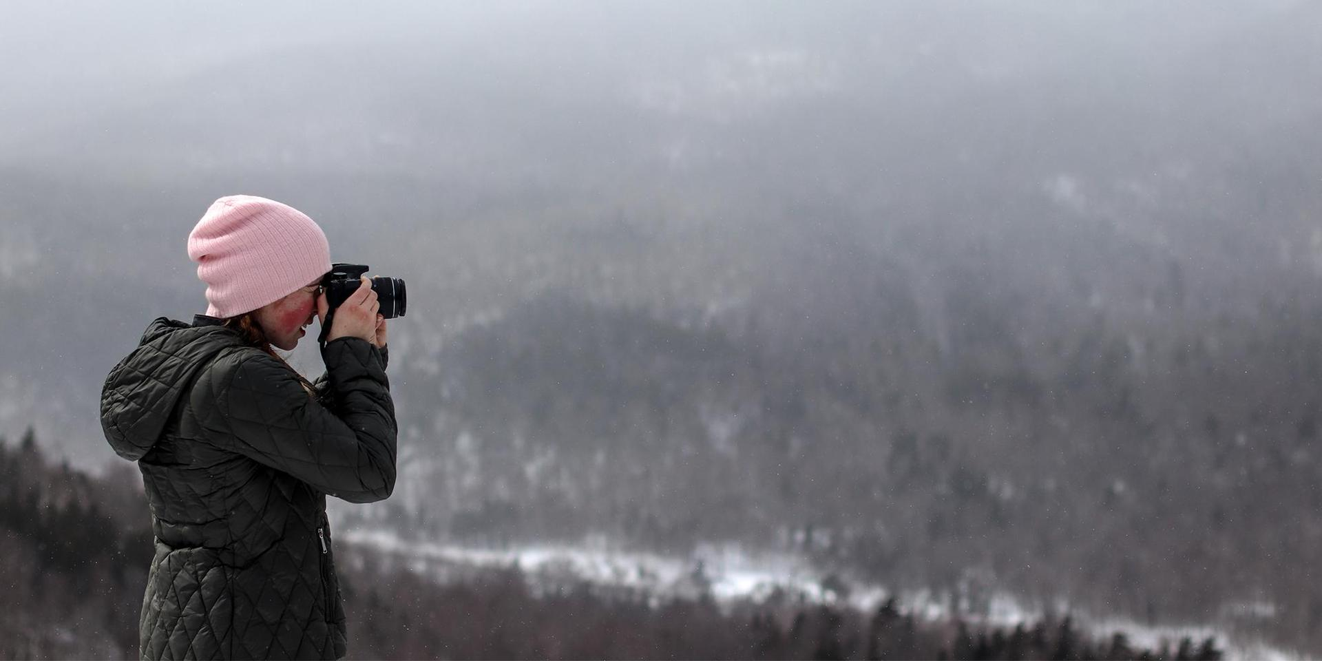 A student practicing winter photography in the White Mountains.