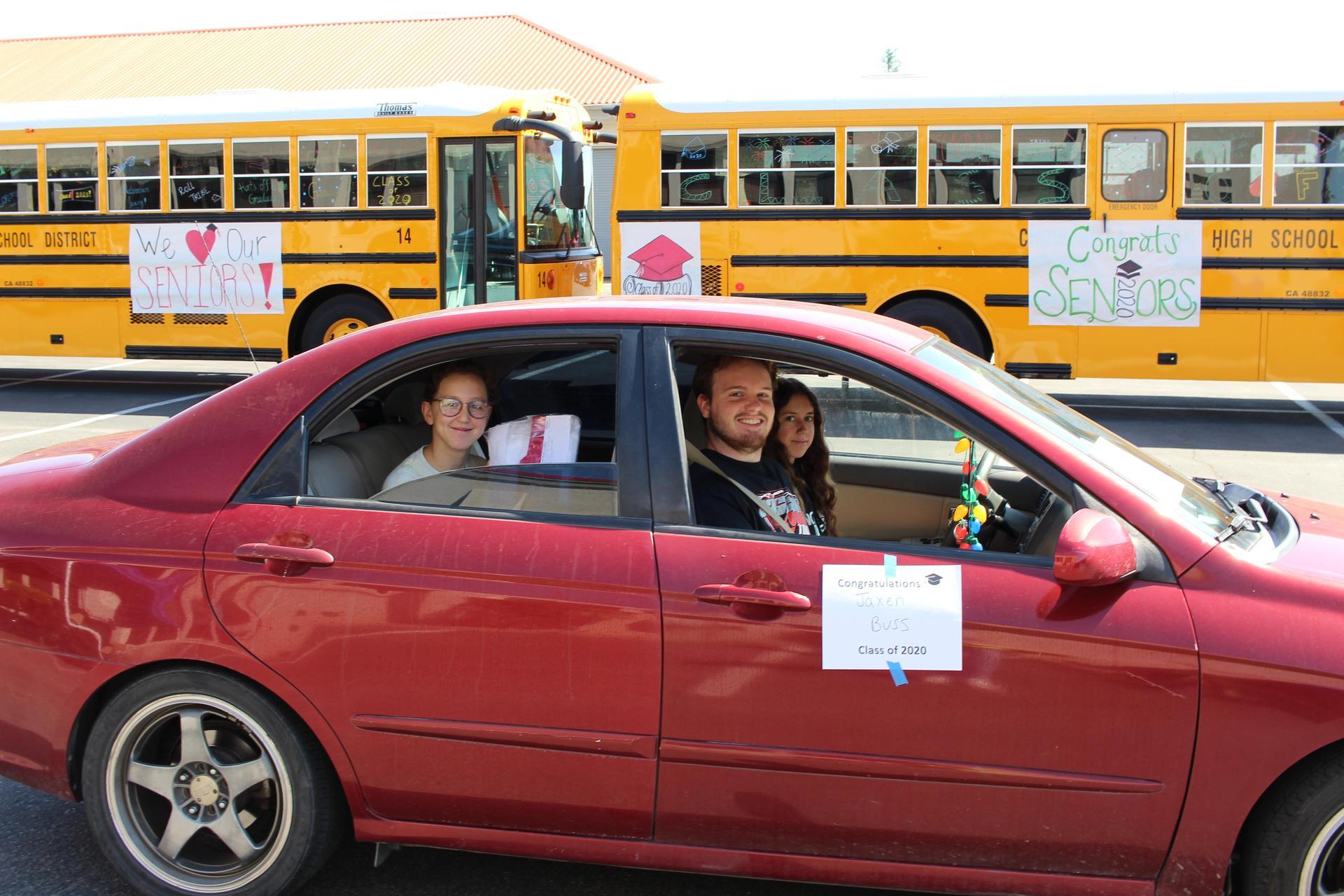 Lauren Bass and Jaxen Buss riding through