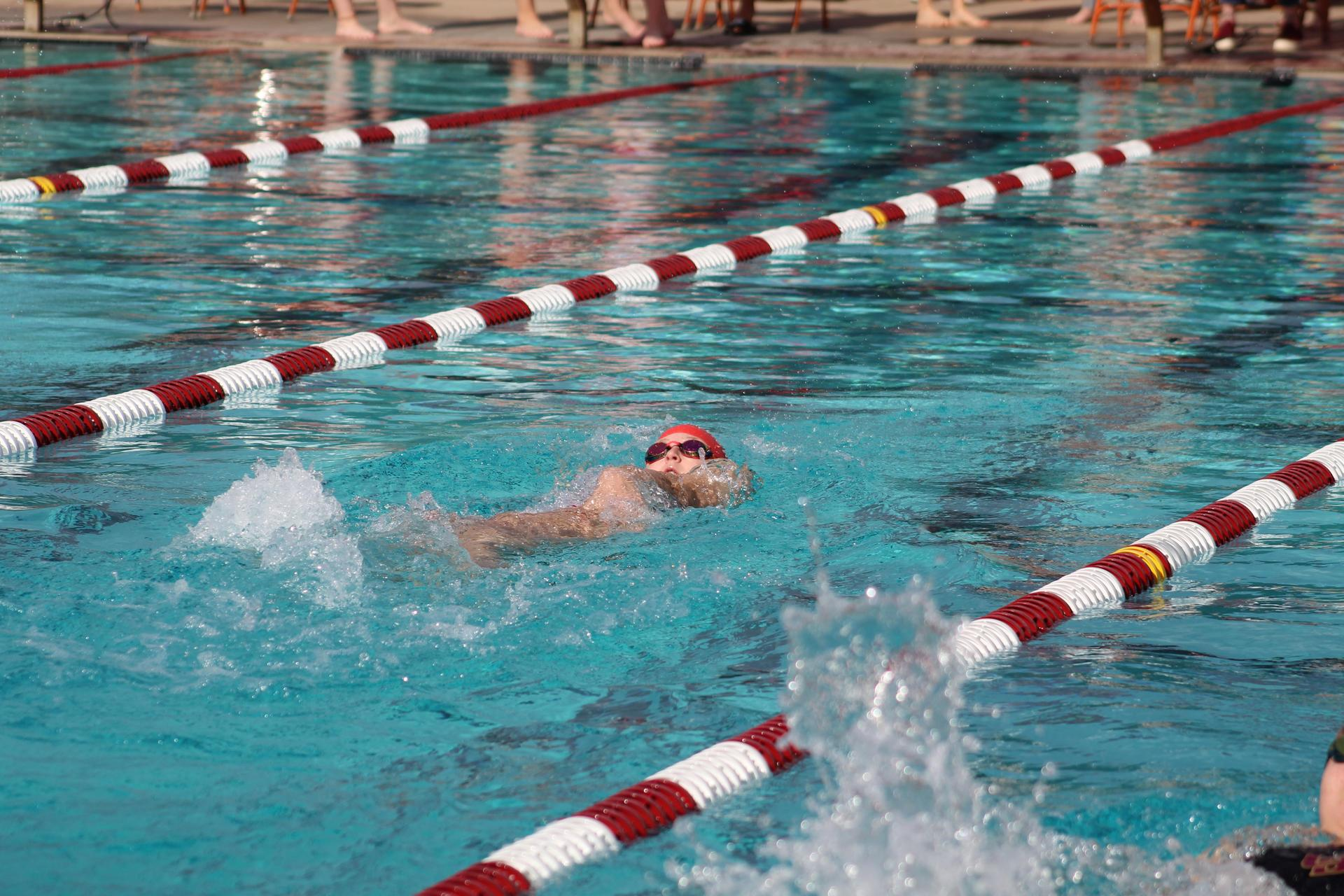 Swimmers competing against Los Banos