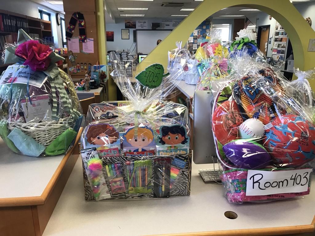 three themed baskets on a table ready for family bingo