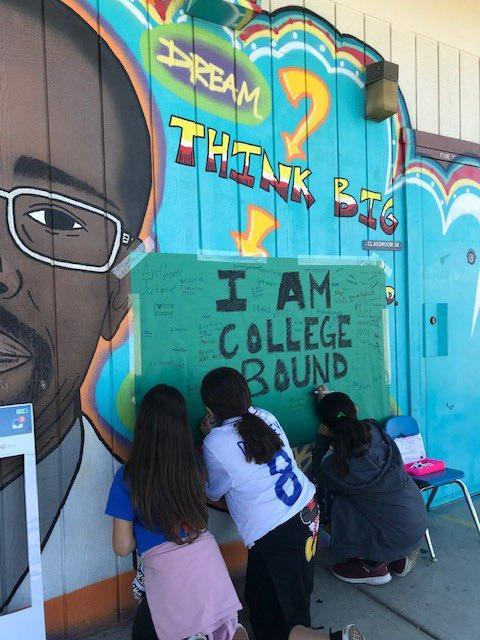 Students sign the wall, and pledge their college bound dreams!