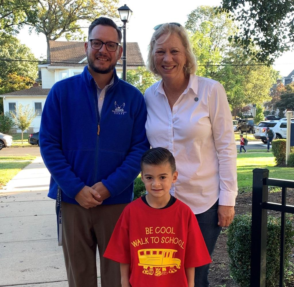 Photo of Westfield Mayor & McKinley principal Dr. Marc Biunno with student on Walk to School Day.