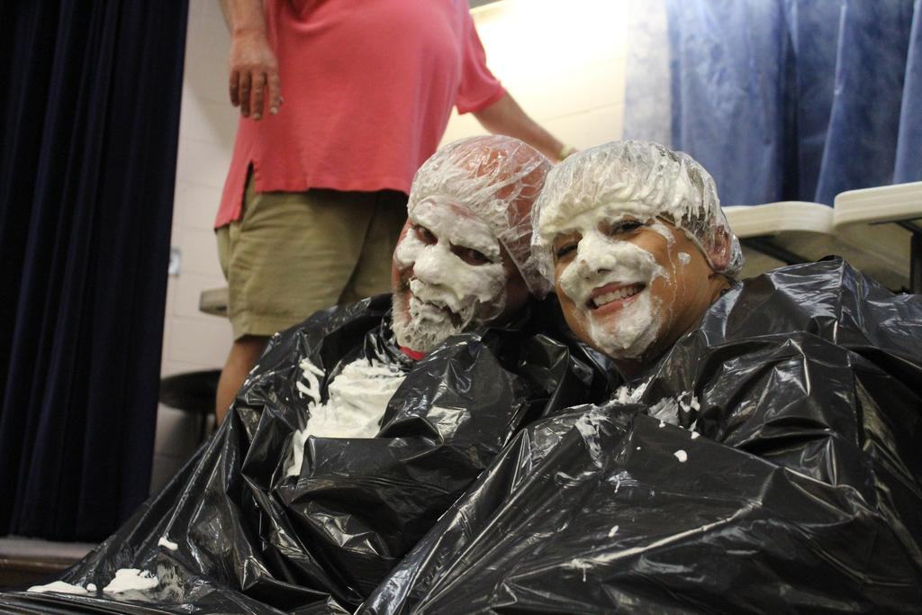 coach and principal with pied faces