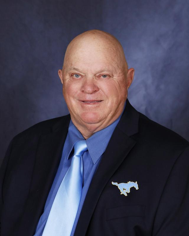 Memorial coach Littleton