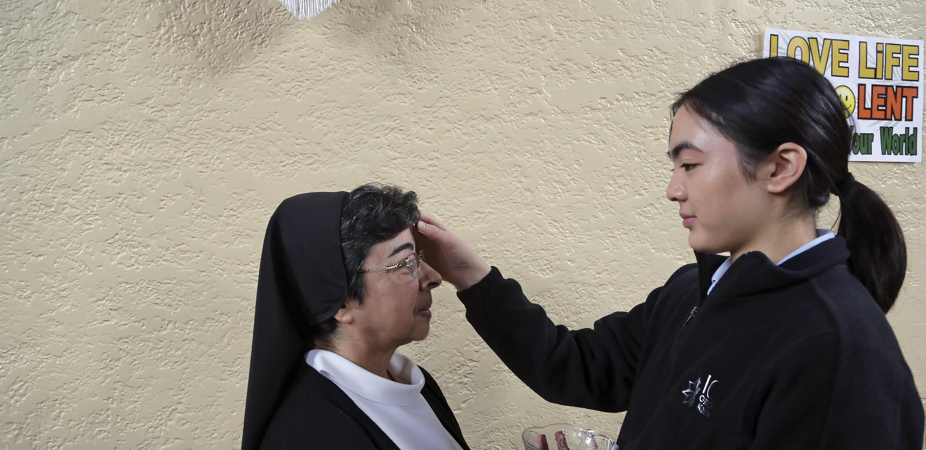Sister Lisa Ann receives ashes from Annika on Ash Wednesday.