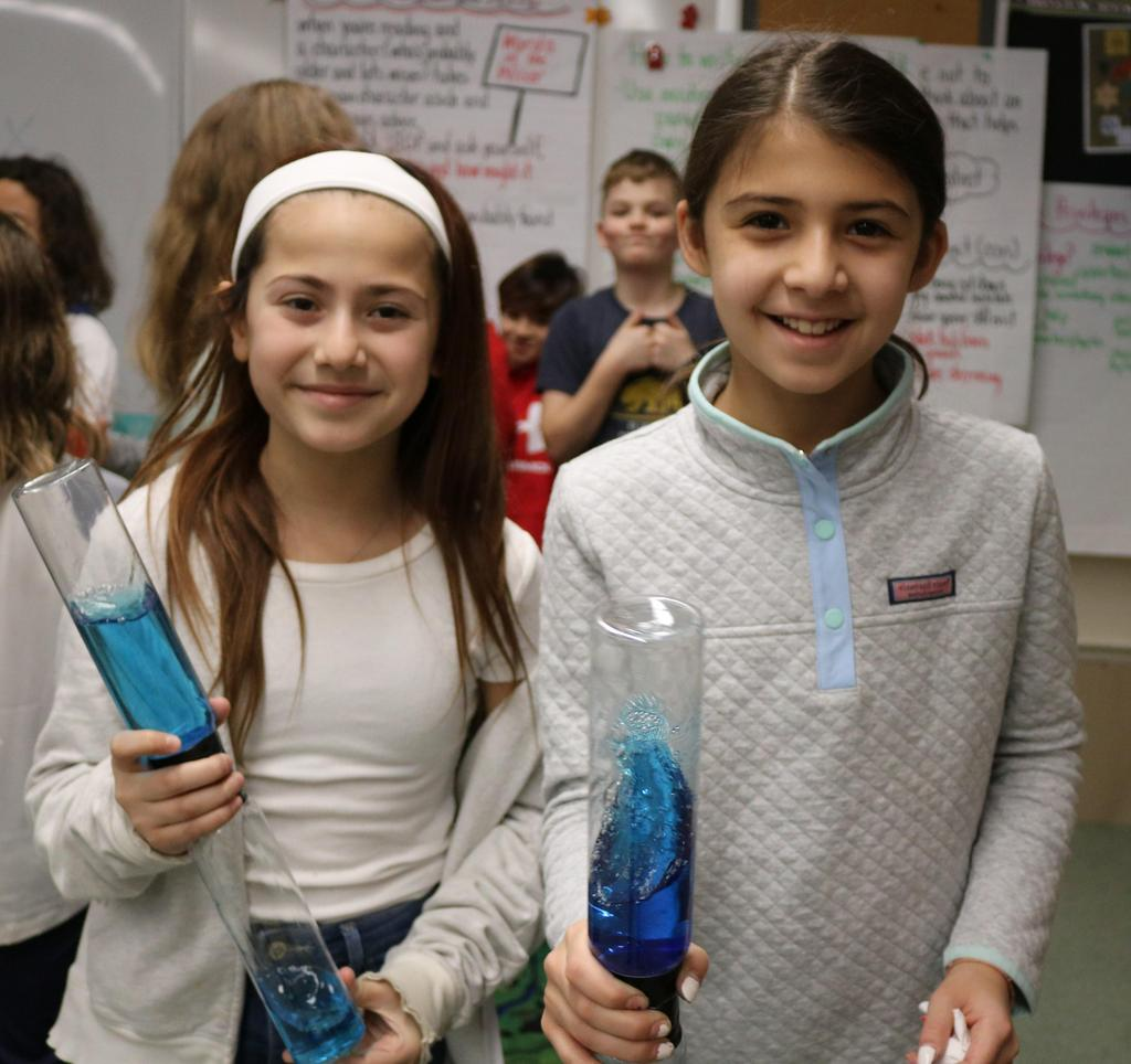 Photo of two Tamaques 5th graders demonstrating a vortex as part of STEAM Day.