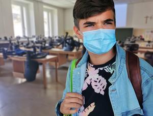 Boy in mask at school