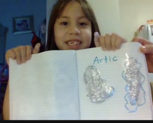 Margaret Oviedo holding up artic drawing