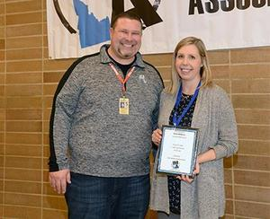 Lone Star Principal Greg Heideman poses with Drew Williams, holding her award.