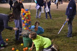 Students play a game at the fall festival.
