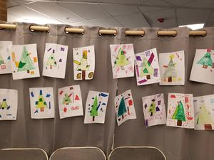 Child-drawn Christmas tress made from geometric shapes.