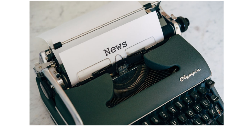 typewriter with the word NEWS on the paper