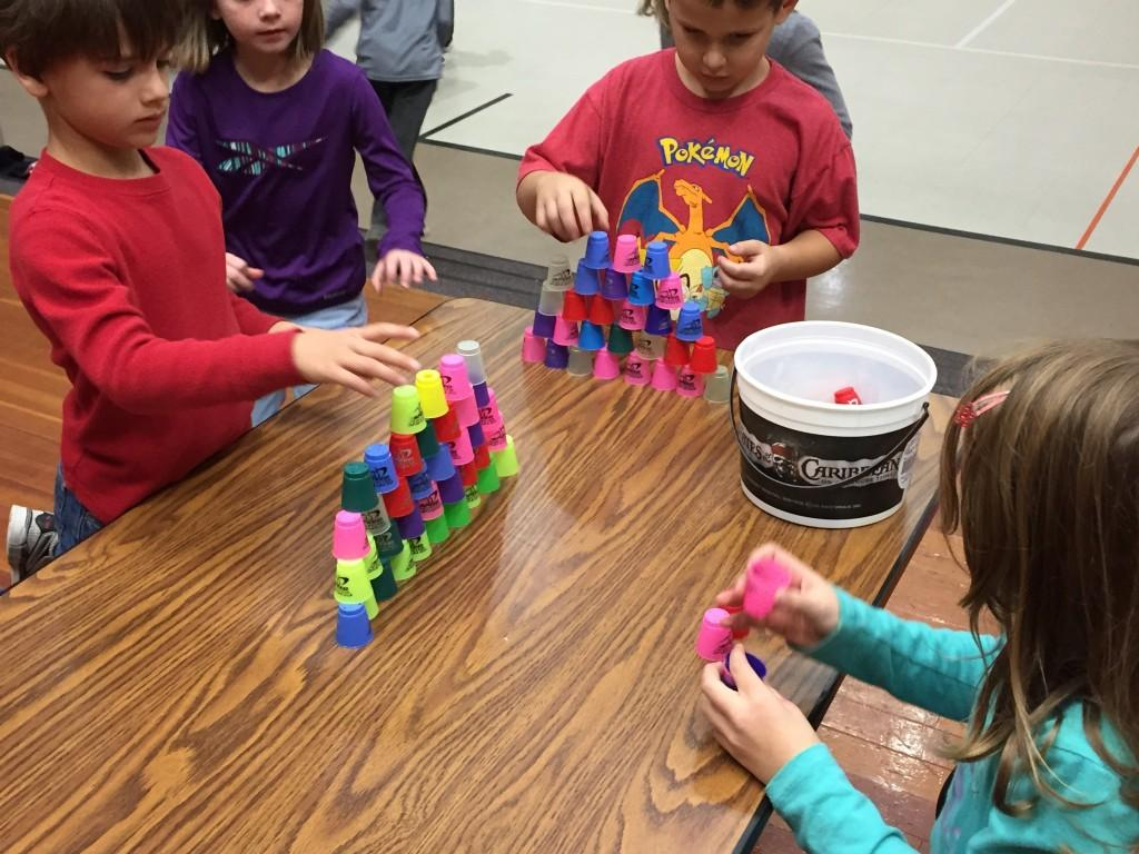 students compete to quickly stack cups