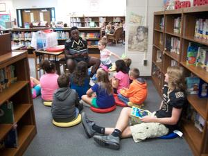 East Davidson football player is reading to students.