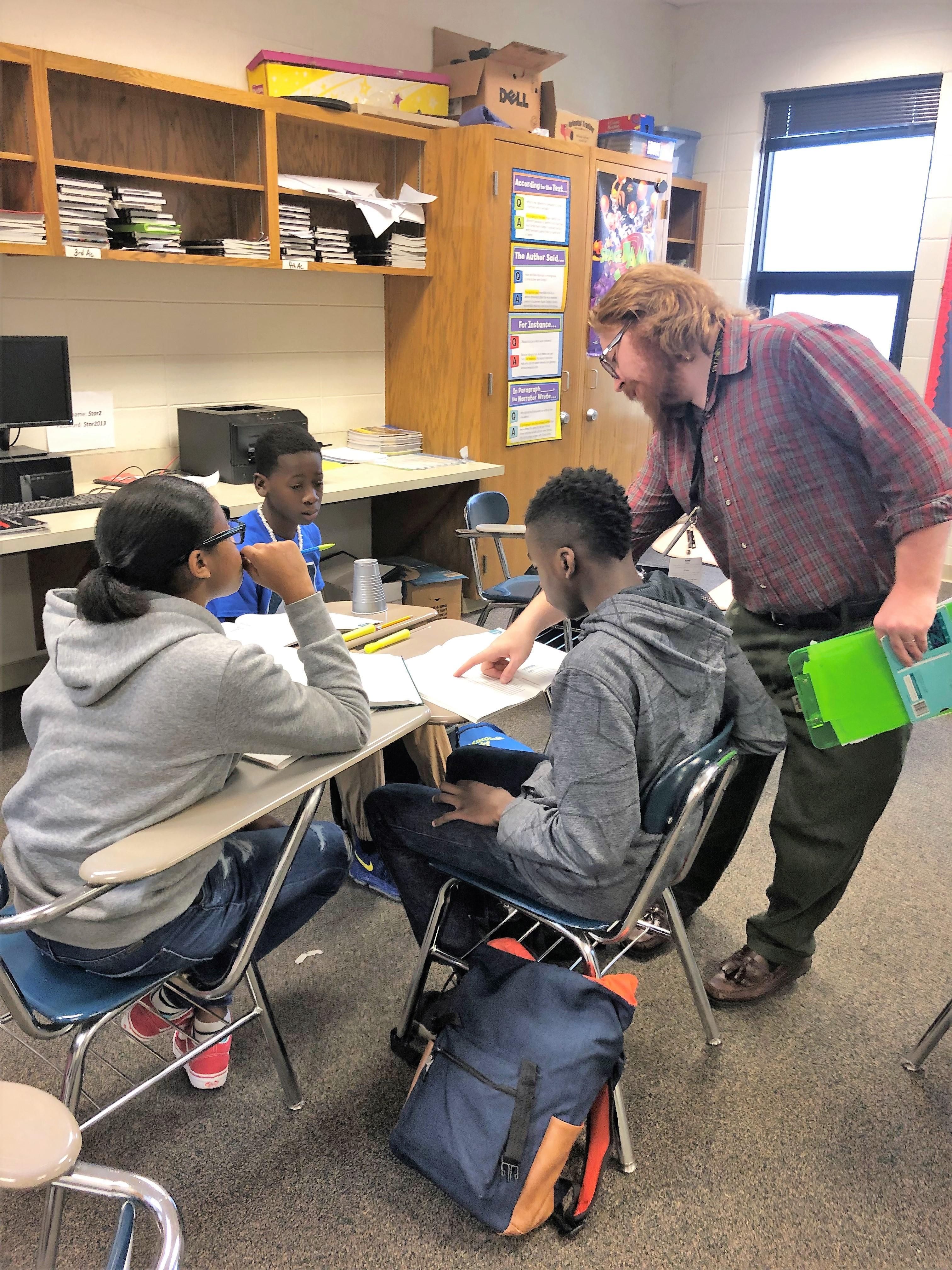 Teacher facilitating student-centered instruction