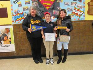 Principal Tierri, Geovana, student of the month, and her mom