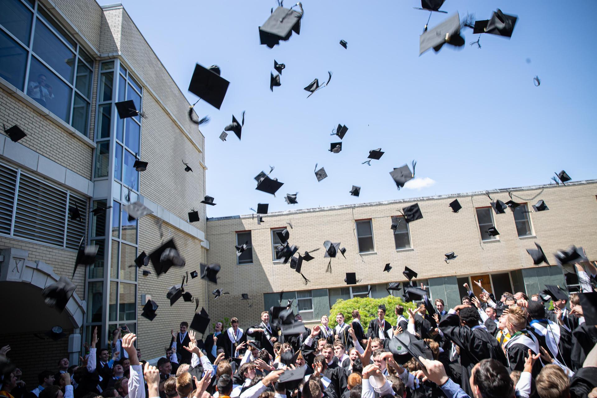 Caps off at graduation