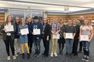 Group picture of students of the month with teachers.
