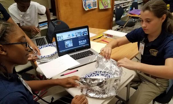 Ms. Perry's 7th grade Science class at MACA are working on solar ovens.