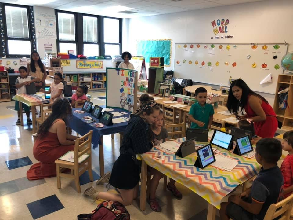 parents looking at children coding work