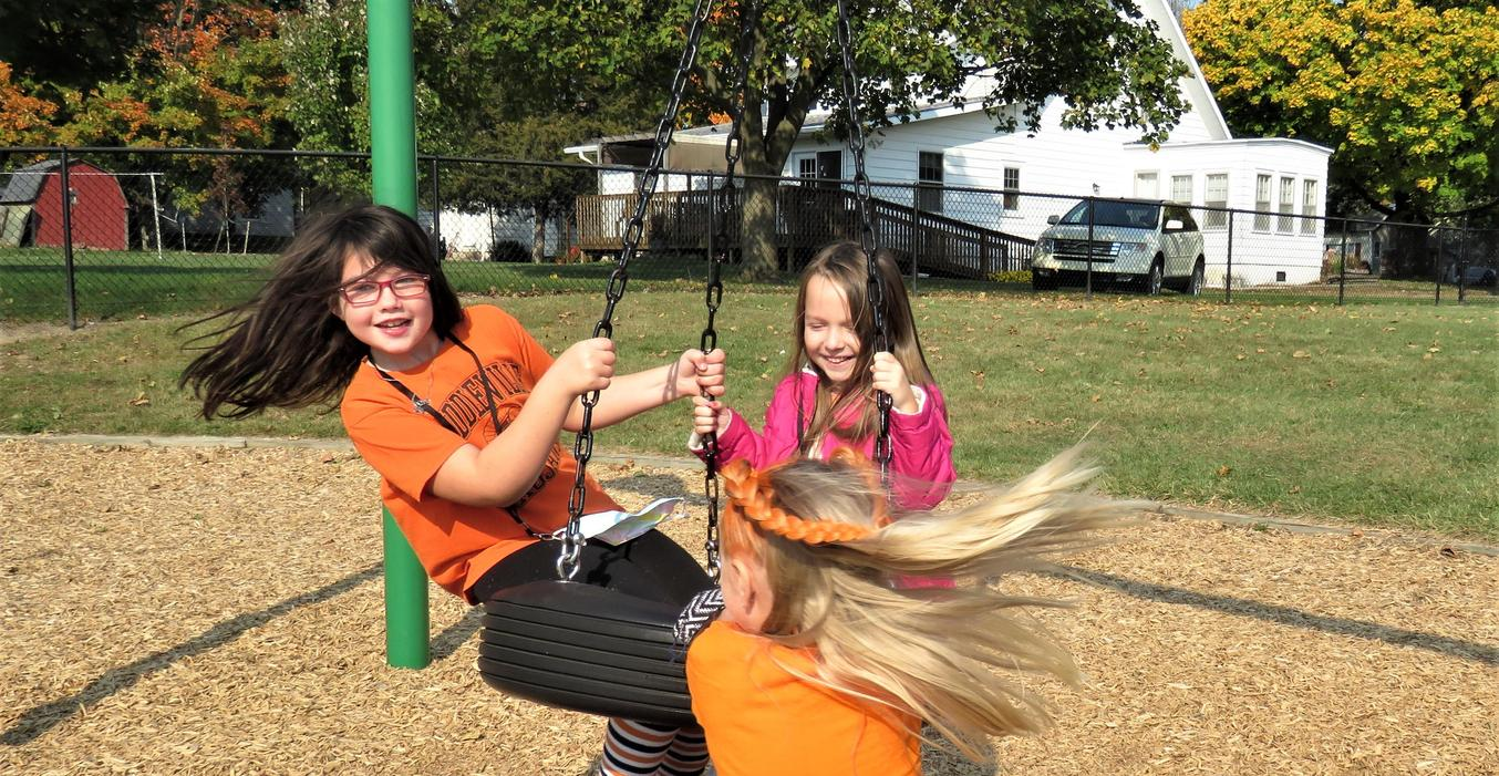 McFall students love spinning round and round on the tire swing.