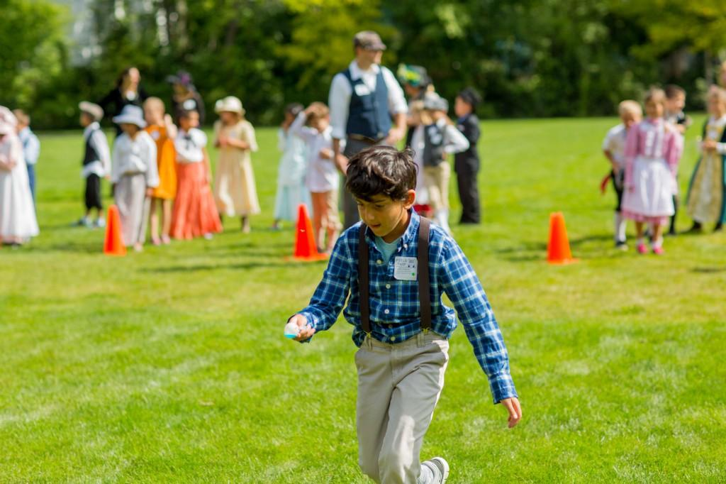 Boy participating in egg race