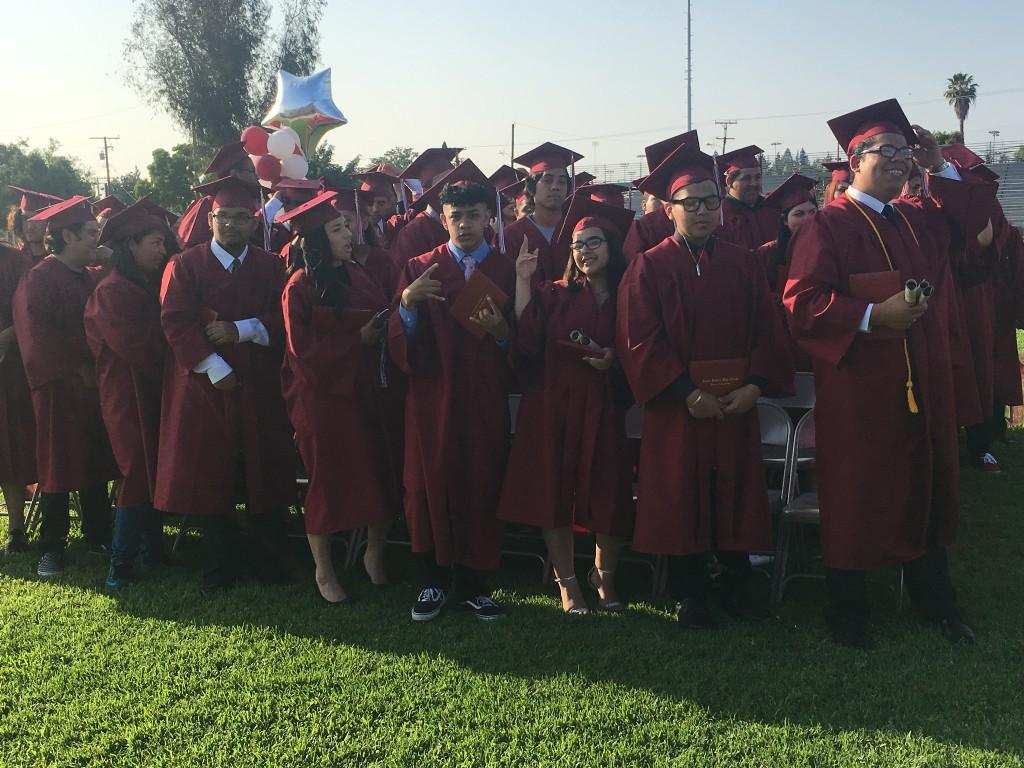 RSHS graduates stand during their commencement ceremony.
