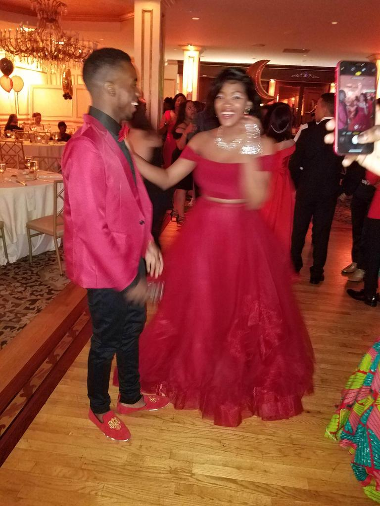 two students dancing on the dance floor