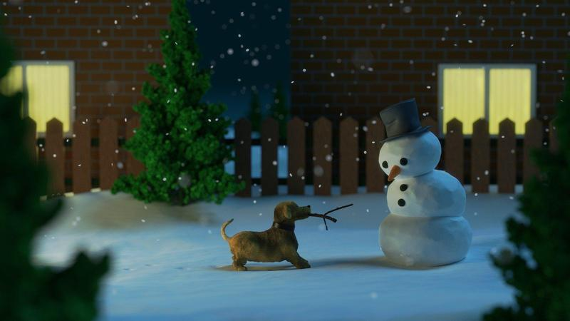Image of dog and snowman in snow