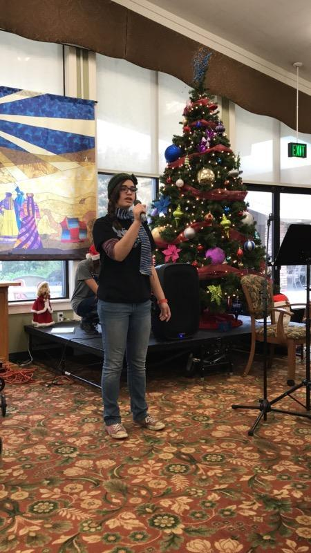 RMCHS student sings at Sierra View Homes.